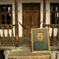 A portrait of Soviet dictator Josef Stalin is seen in front of Stalin's birth place in his hometown of Gori some 80 km (50 miles) west of Tbilisi